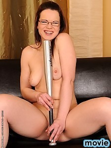 Shy girl in glasses stretched by baseball bat